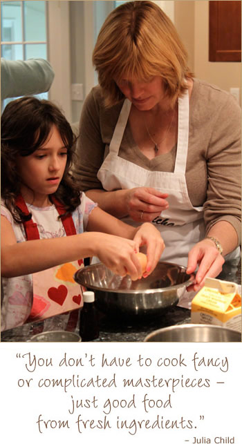 Adult and child baking